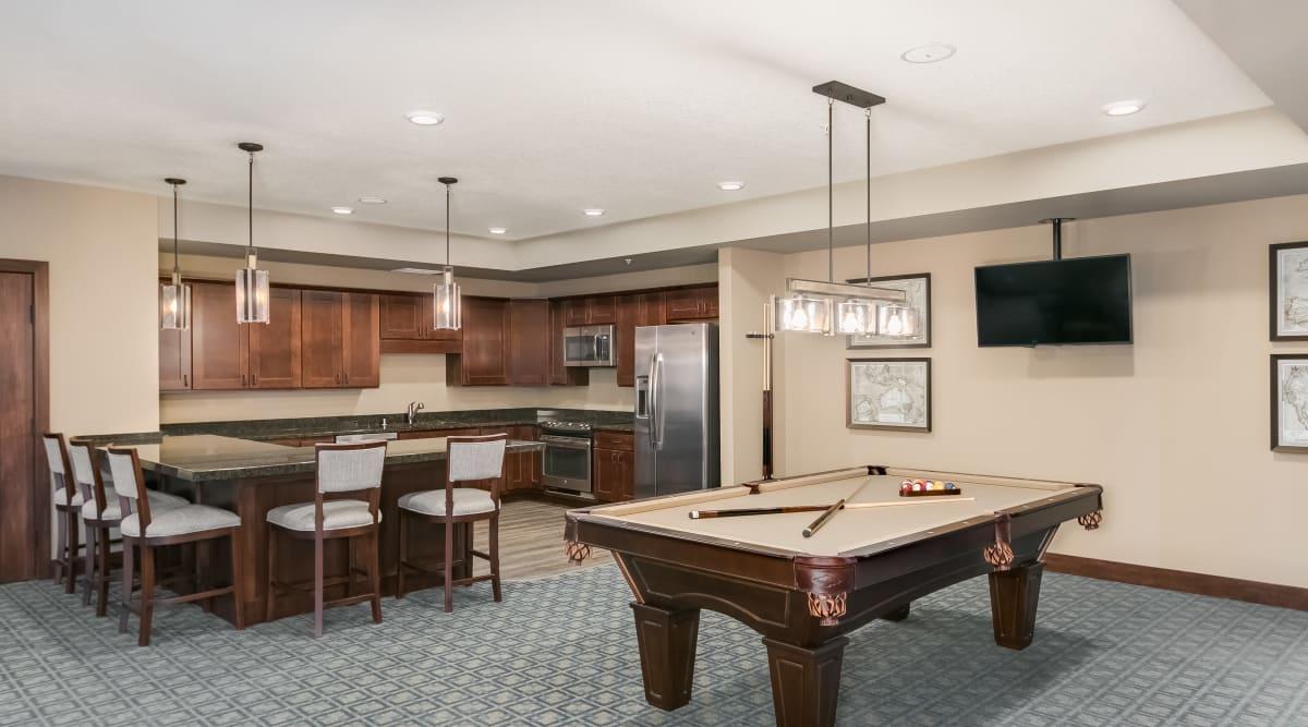 Billiards room and kitchen area at Applewood Pointe of Lake Elmo in Lake Elmo, Minnesota