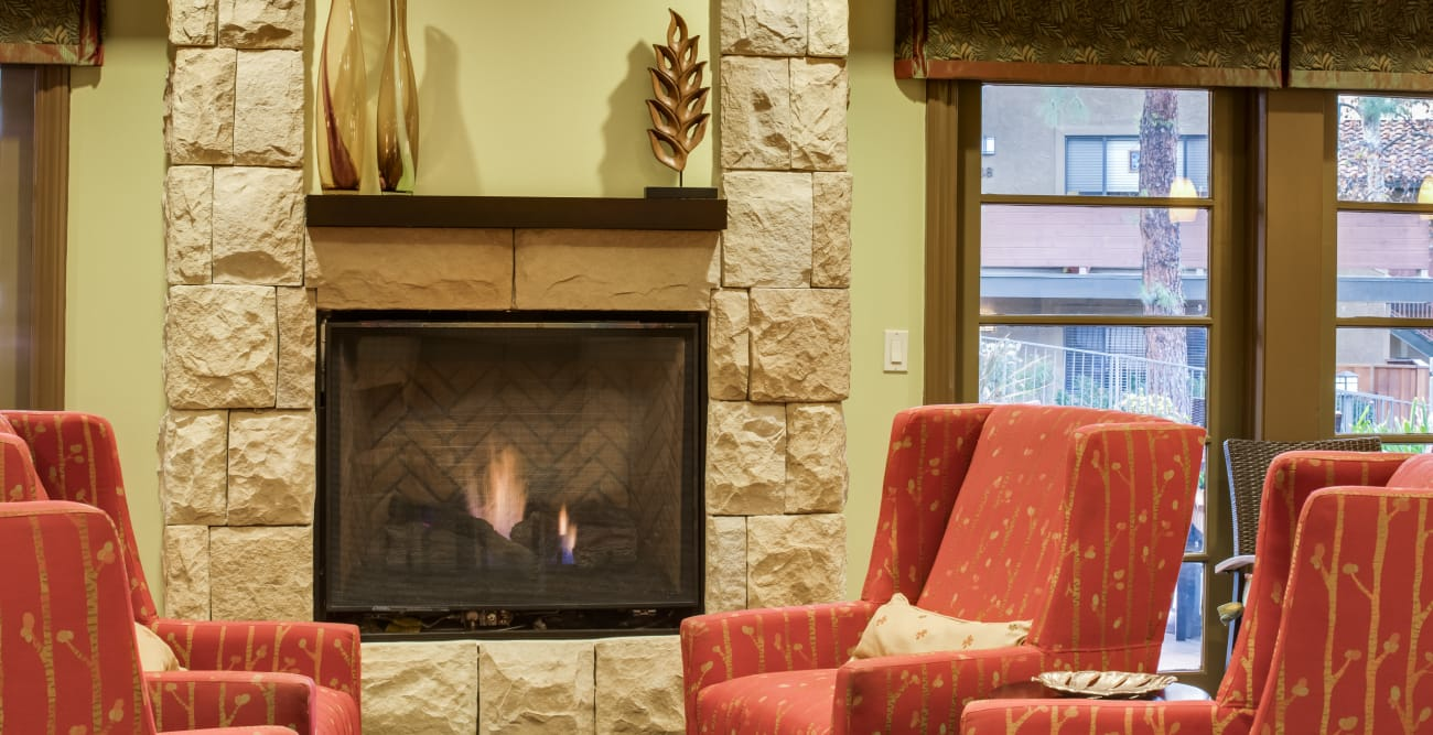 Fireplace and comfy seats at The Reserve at Thousand Oaks in Thousand Oaks, California