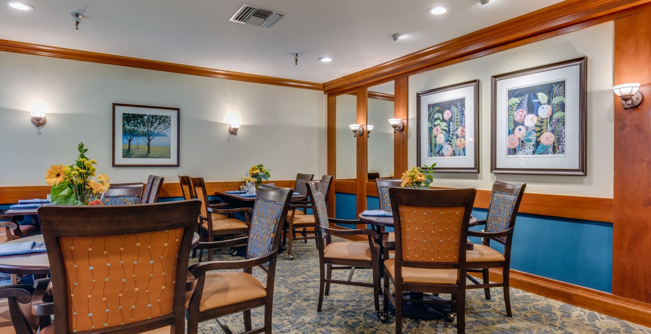 Dining room with a beautiful decoration of paintings at The Firs in Olympia, Washington