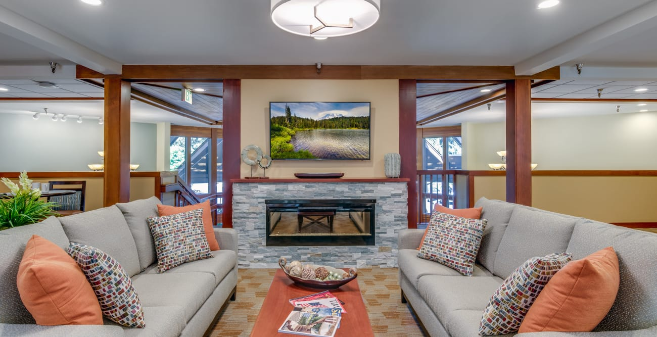 Tv room and fireplace at The Firs in Olympia, Washington