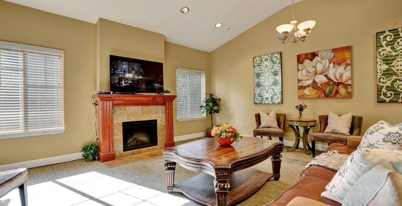 seating area with fireplace and TV