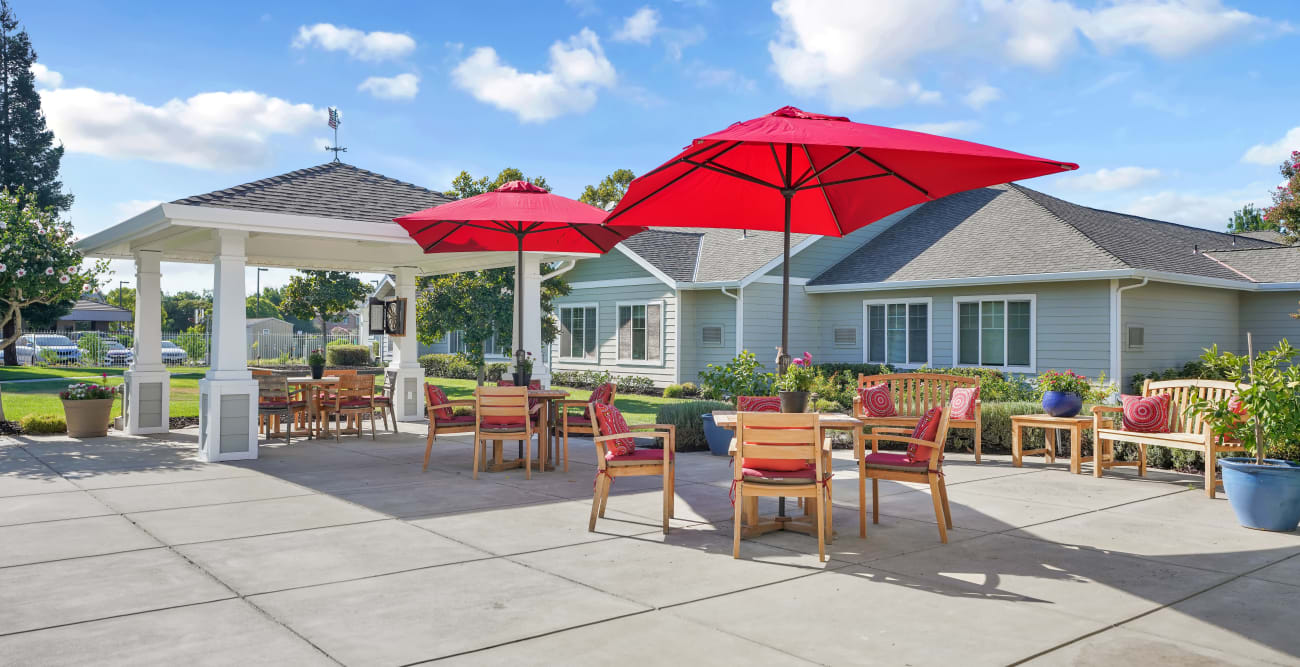 outdoor patio with chairs and umbrellas