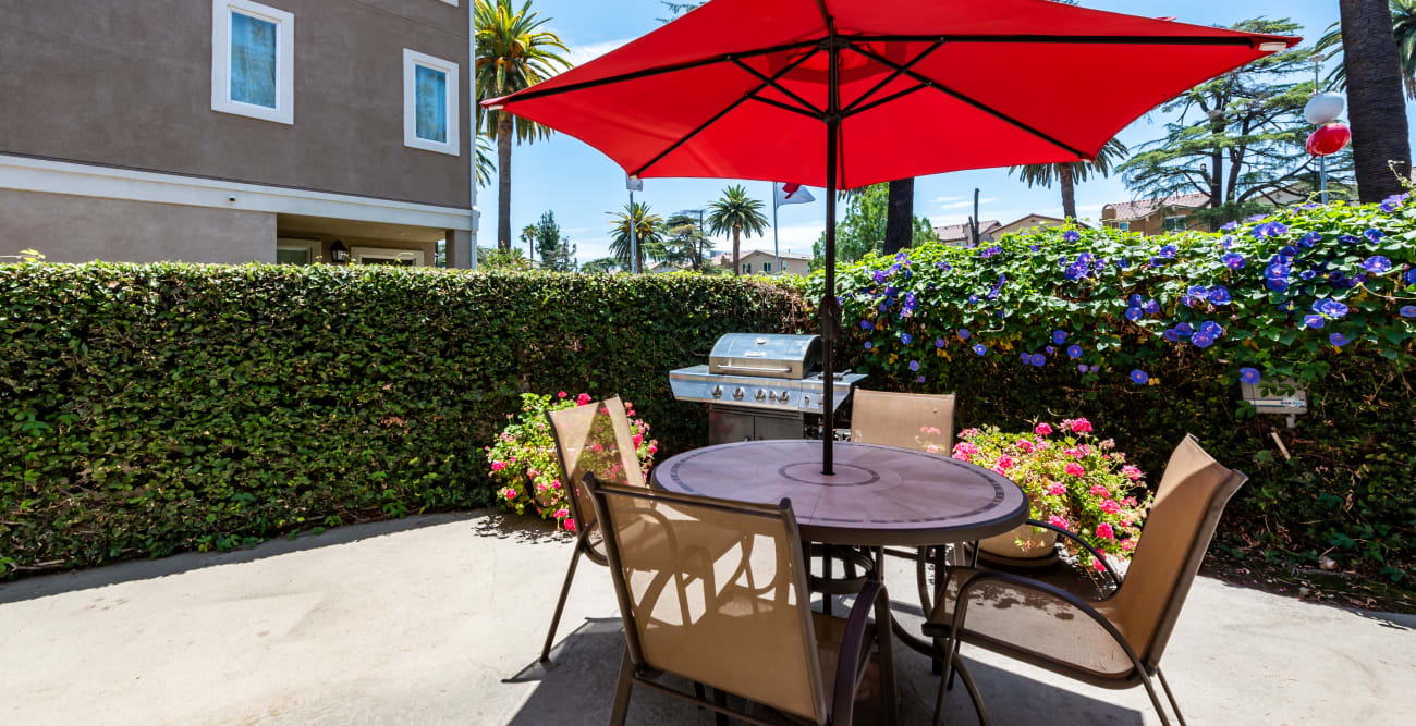 Sun deck social area with BBQ grills at The Crossroads in Van Nuys, California
