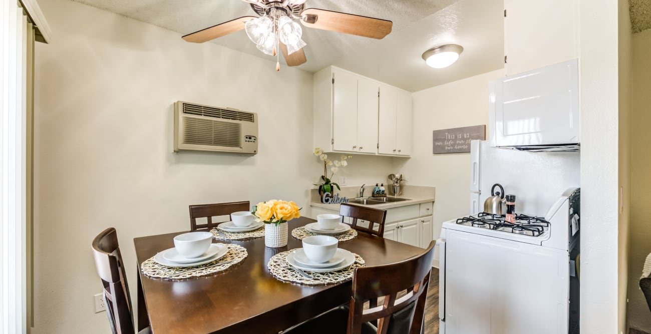 Dining table and kitchen area at The Crossroads in Van Nuys, CA