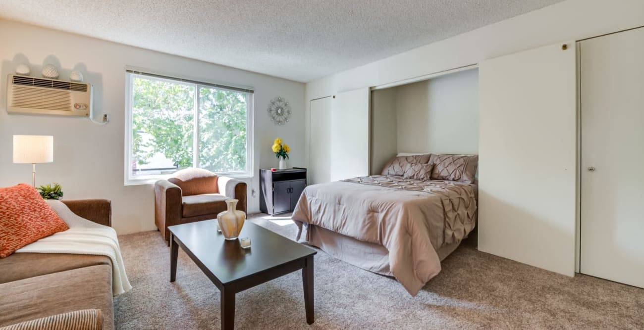 Living room with murphy bed at The Embassy Apartments in Sherman Oaks, California
