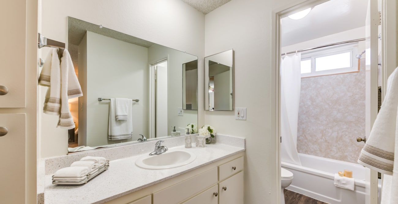 Bathroom with modern fixtures at The Embassy Apartments in Sherman Oaks, California