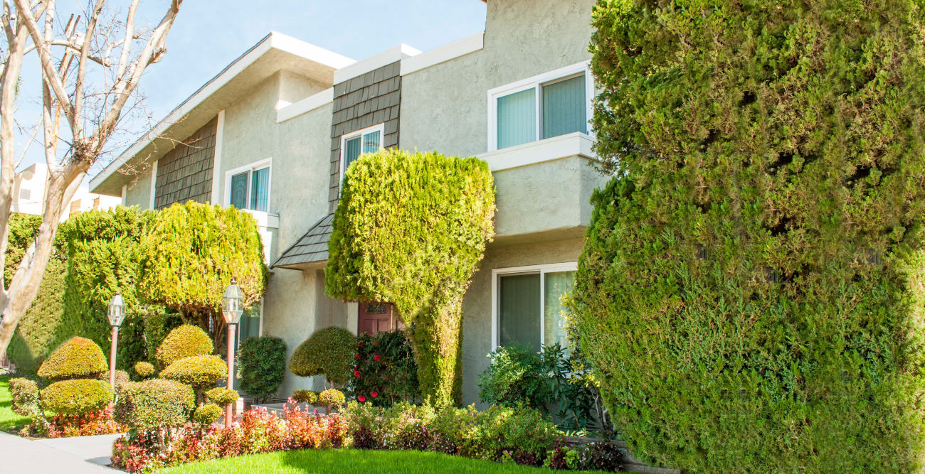 Exterior and lawn at The Embassy Apartments in Sherman Oaks, California
