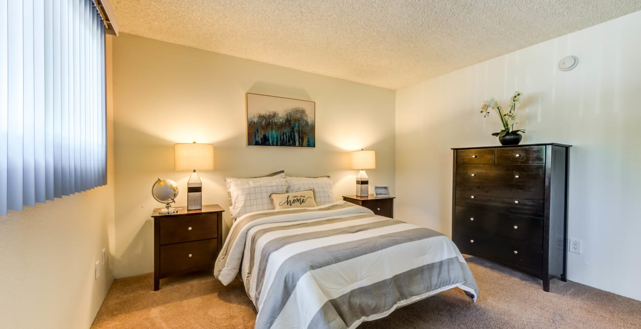 Warm and inviting bedroom at The Embassy Apartments in Sherman Oaks, California