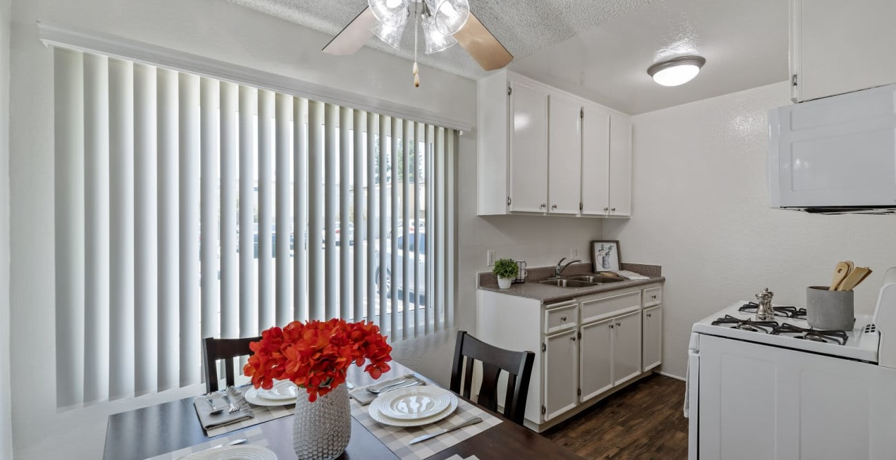 Bright kitchen with large window and wood flooring at The Esplanade in Lake Balboa, California