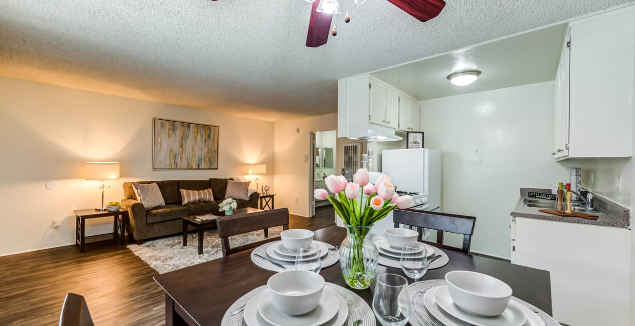 Table set for four in open living floor plan at The Esplanade in Lake Balboa, California