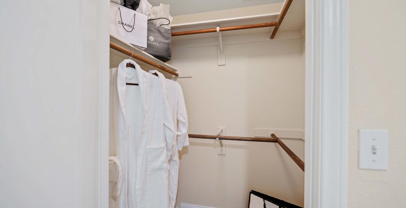 Spacious walk-in closet with built-in organizer at The Villagio in Northridge, California