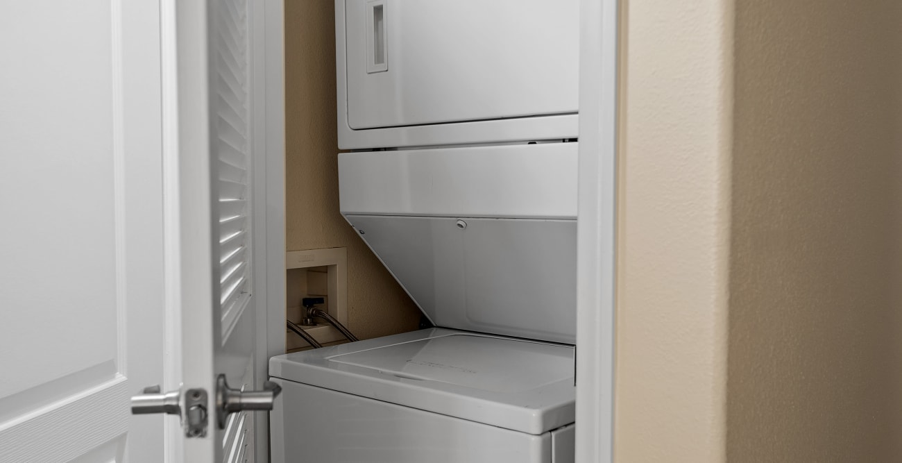 In-unit stacked washer and dryer at The Villagio in Northridge, CA