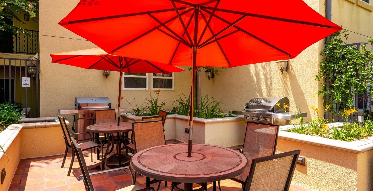 Social area with BBQ grills at The Villagio in Northridge, California