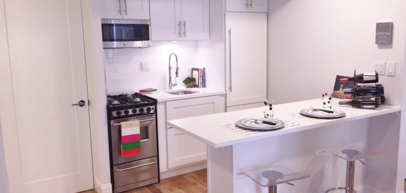 Kitchen with a breakfast bar at 210-220 E. 22nd Street in New York, New York