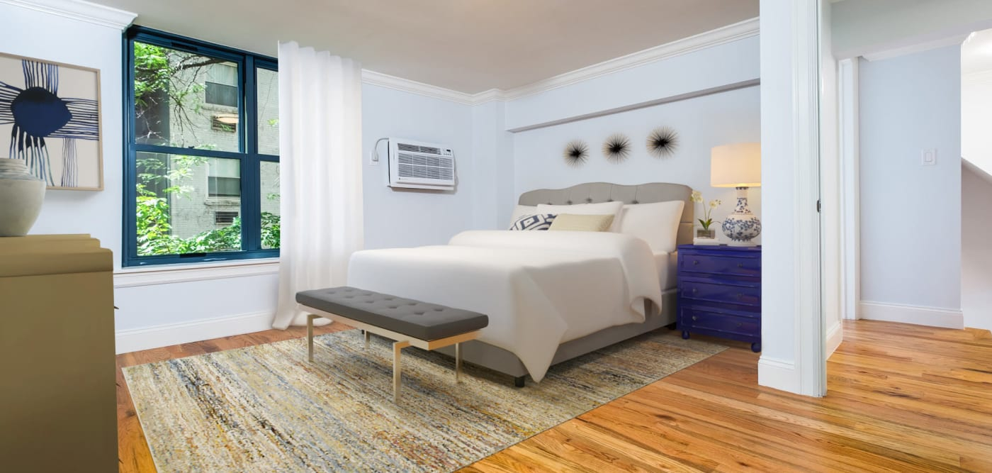 Large bedroom with large windows at 210-220 E. 22nd Street in New York, New York