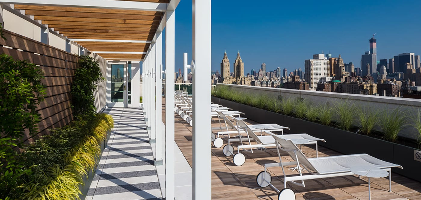 Roof-top lounge with plenty of lounge chairs for sunbathing at The Larstrand in New York, New York