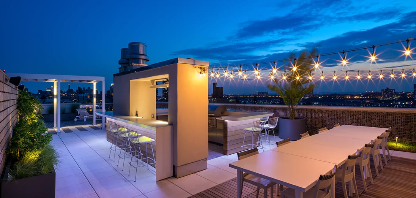 Roof top lounge with plenty of seating for entertaining guests at The Larstrand in New York, New York