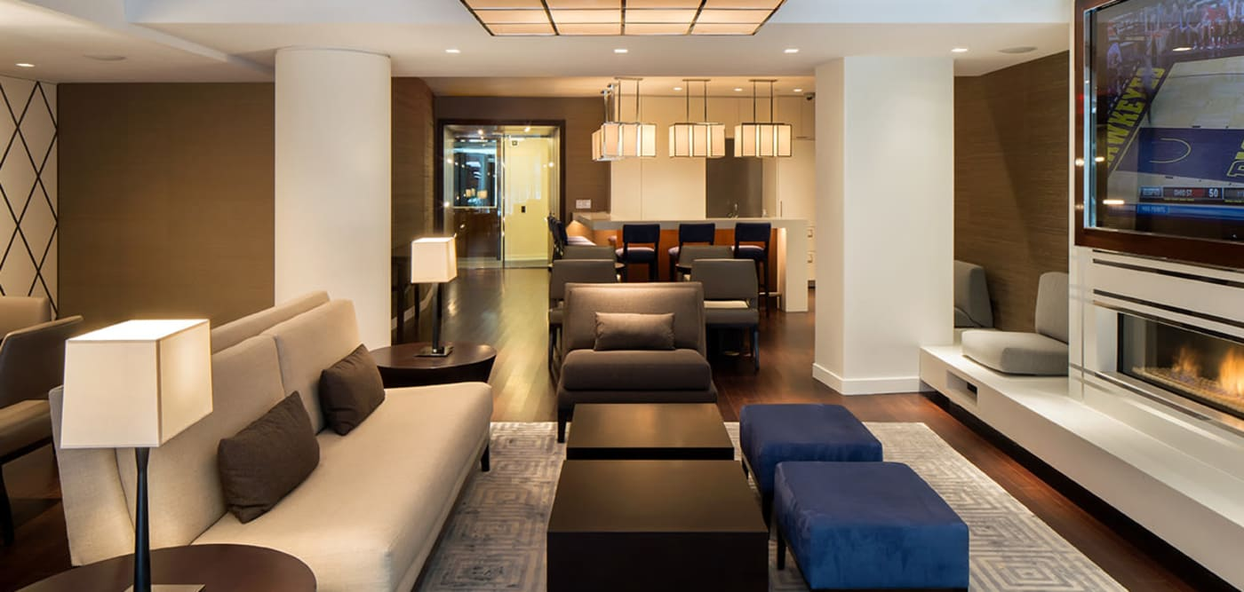 Clubhouse lounge with a fireplace and a flat-screen TV at The Larstrand in New York, New York