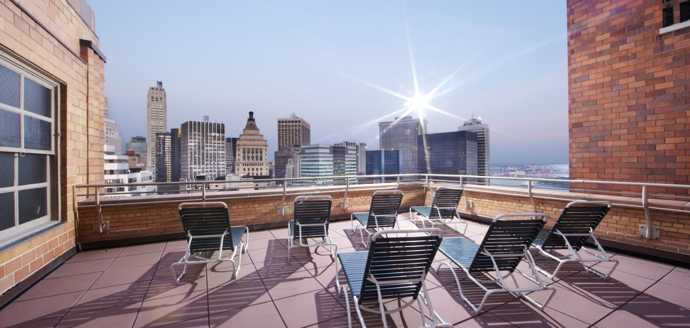 Rooftop patio with lounge chairs at 21 West Street in New York, New York