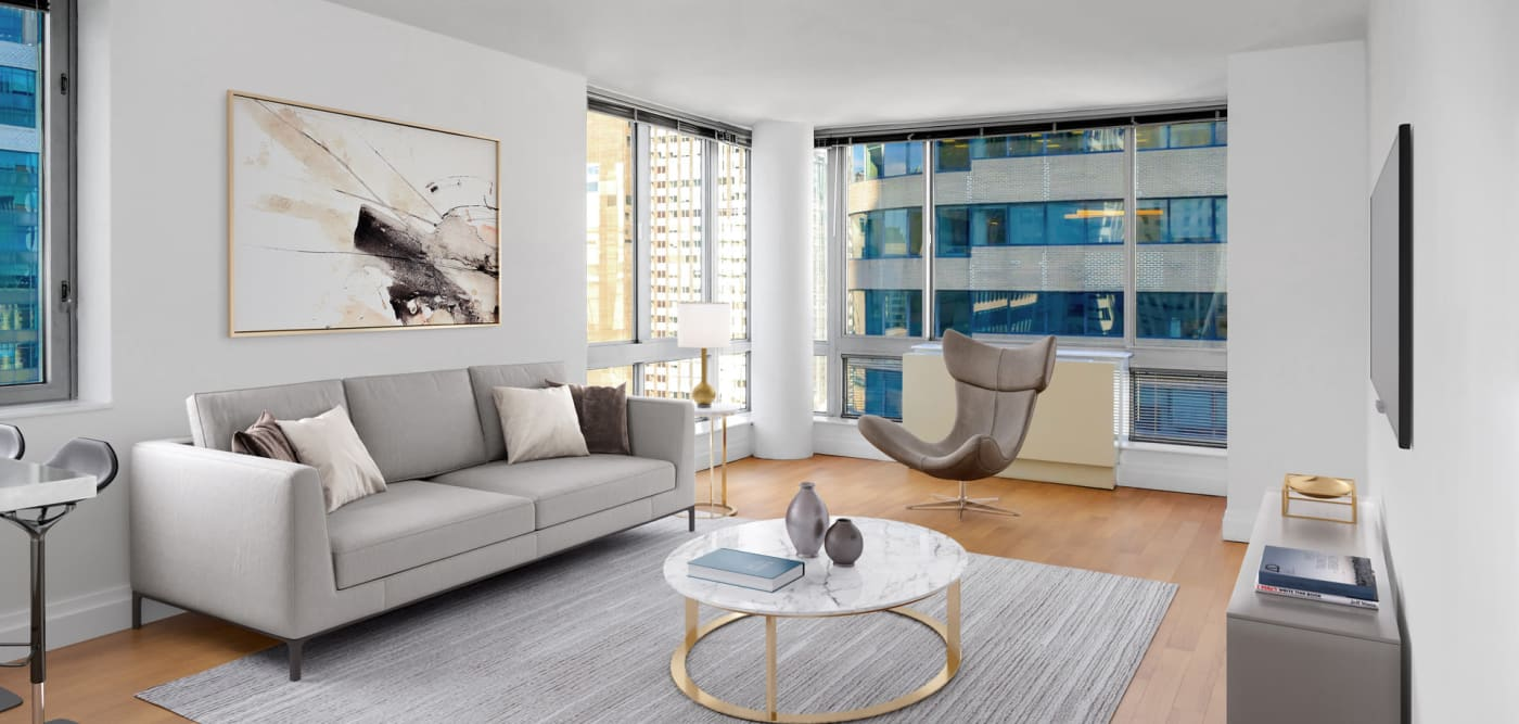 A living room with lots of windows for natural lighting at The Metropolis in New York, New York