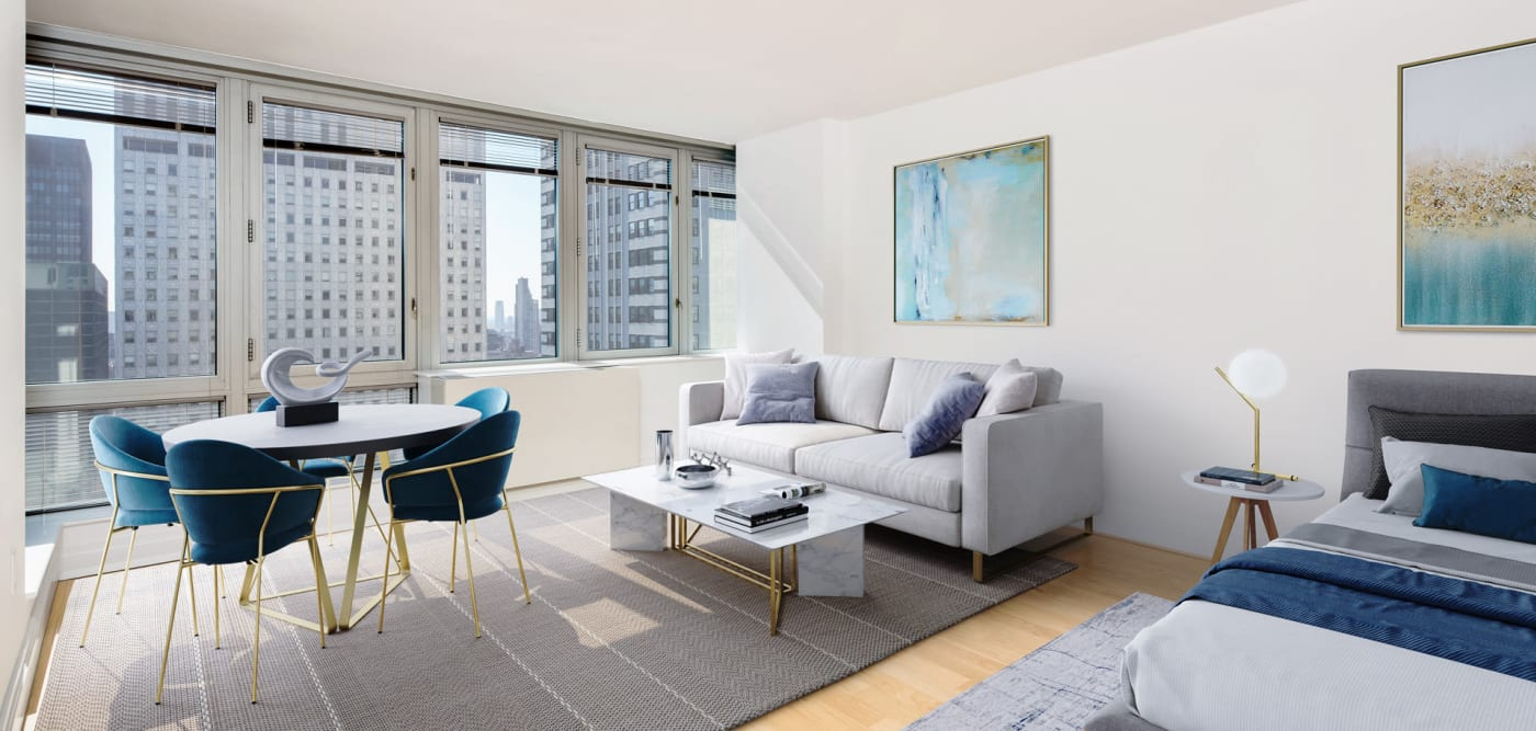 A studio apartment with wood-style flooring at The Metropolis in New York, New York