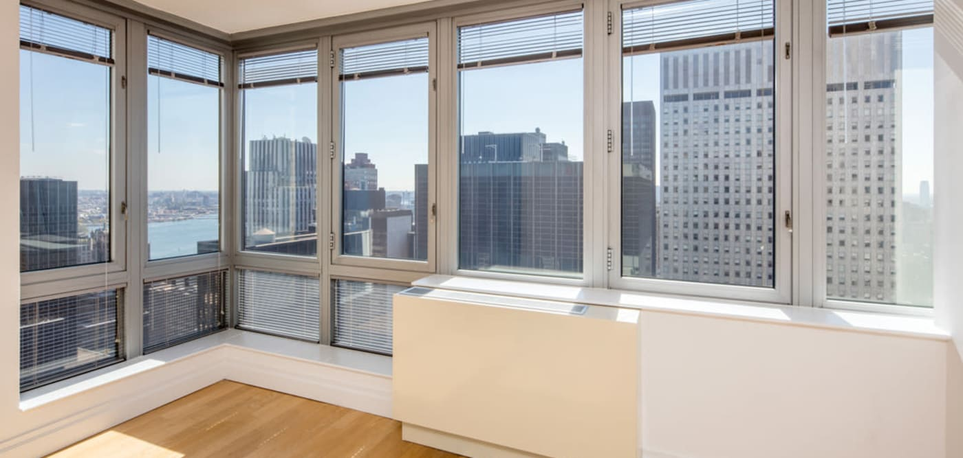 A windowed wall in the living room at The Metropolis in New York, New York