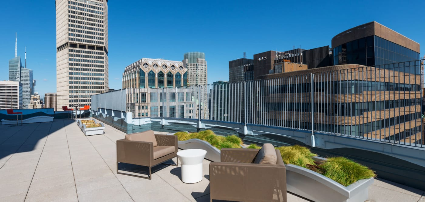 A spacious rooftop deck with wind cover at The Metropolis in New York, New York