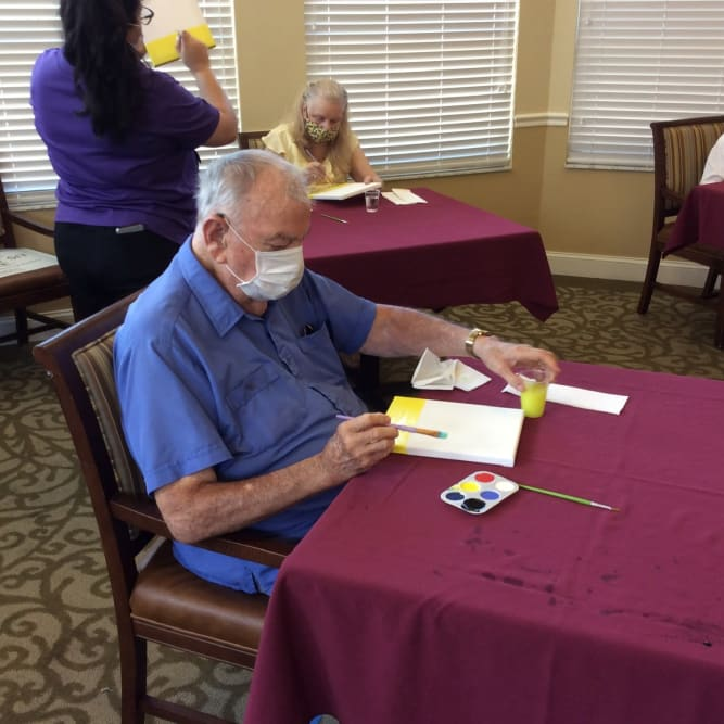 Residents painting at Grand Villa of Palm Coast in Palm Coast, Florida