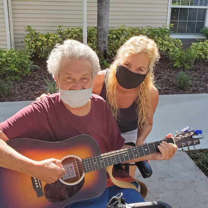 resident playing a guitar