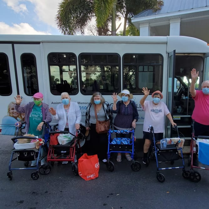 senior residents getting on the community bus