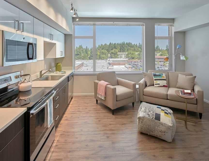 Living room at The Maverick with a view of Burien, WA