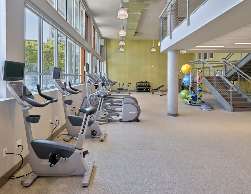 Fitness center with natural light at The Maverick in Burien, WA