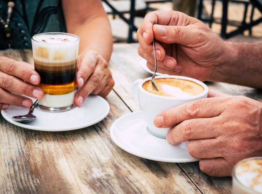 Seniors enjoying coffee at Regency Palms Oxnard in Oxnard, California