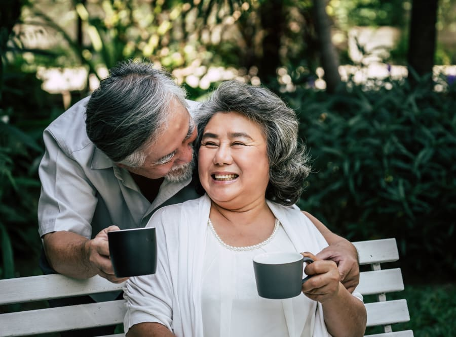 Two residents enjoying a morning cup of coffee at Regency Palms Oxnard in Oxnard, California