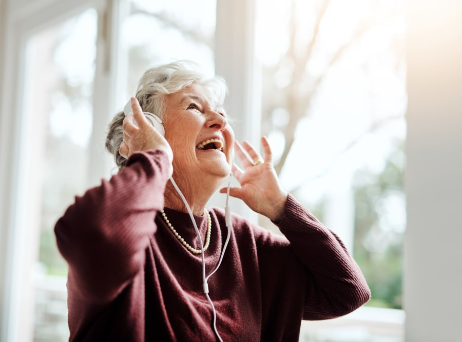 Resident listening to music at Regency Palms Long Beach in Long Beach, California