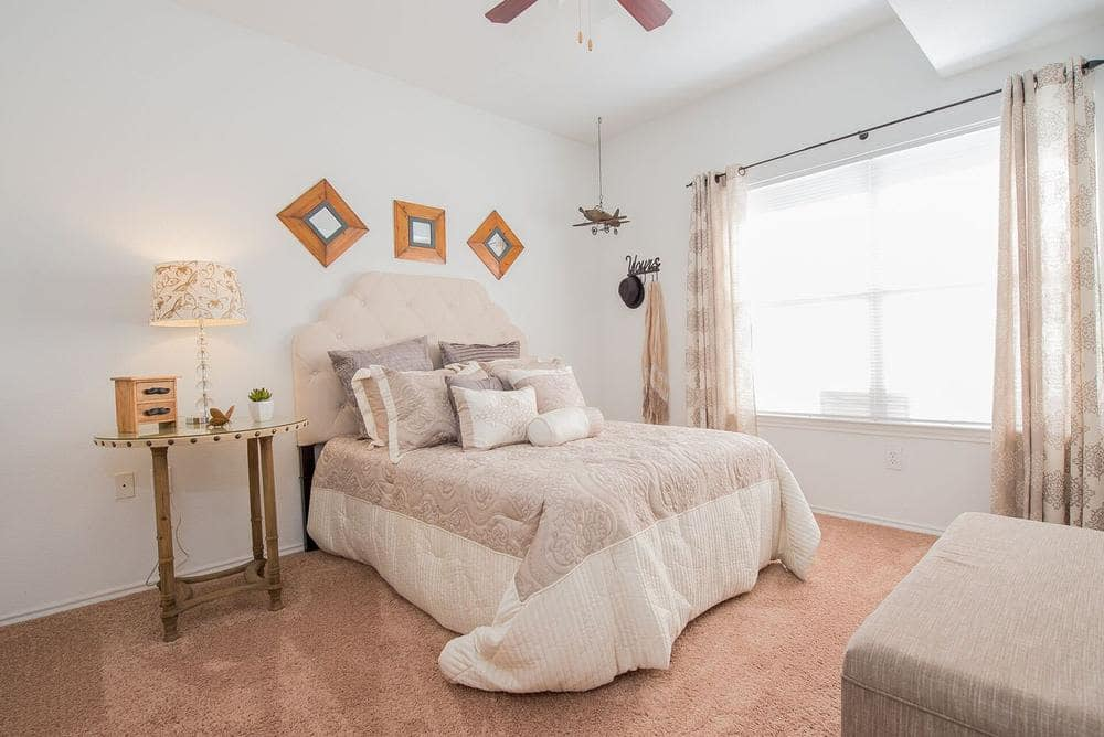 Enjoy a beautiful bedroom at The Pointe of Ridgeland