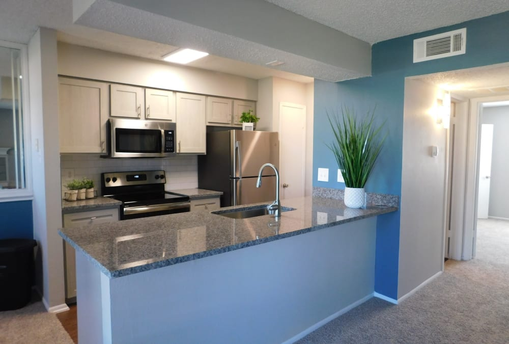 Open-concept floor plan with hardwood floors  at Royal Palms in San Antonio, Texas