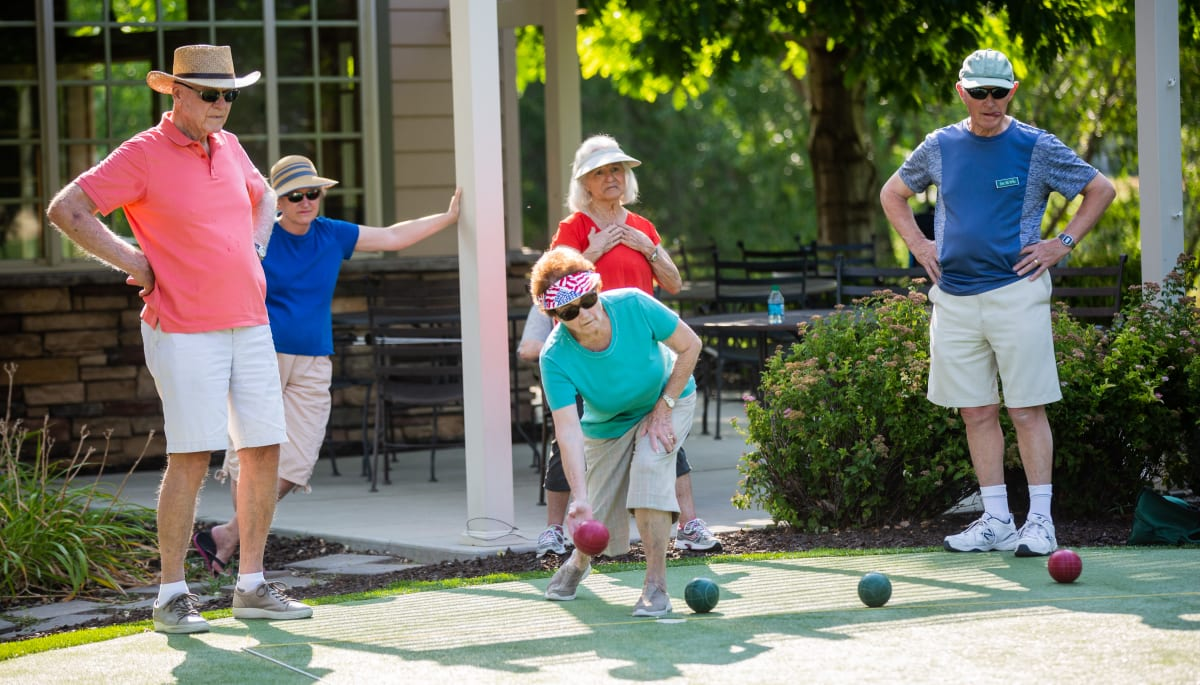 Residents playing an outdoor game at Touchmark at Mount Bachelor Village in Bend, Oregon