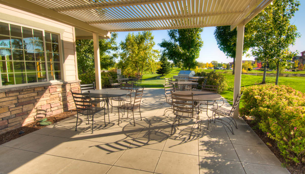 Outdoor seating on the clubhouse patio at Touchmark at Meadow Lake Village in Meridian, Idaho