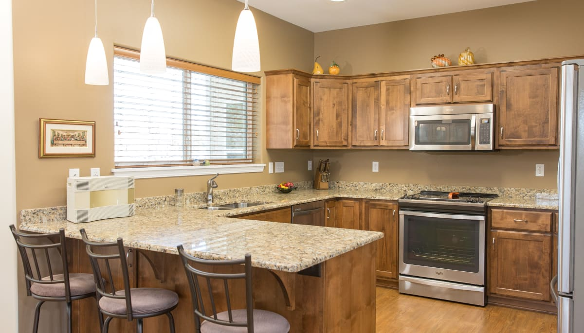 Stainless steel appliances in an apartment kitchen at Touchmark at Harwood Groves in Fargo, North Dakota