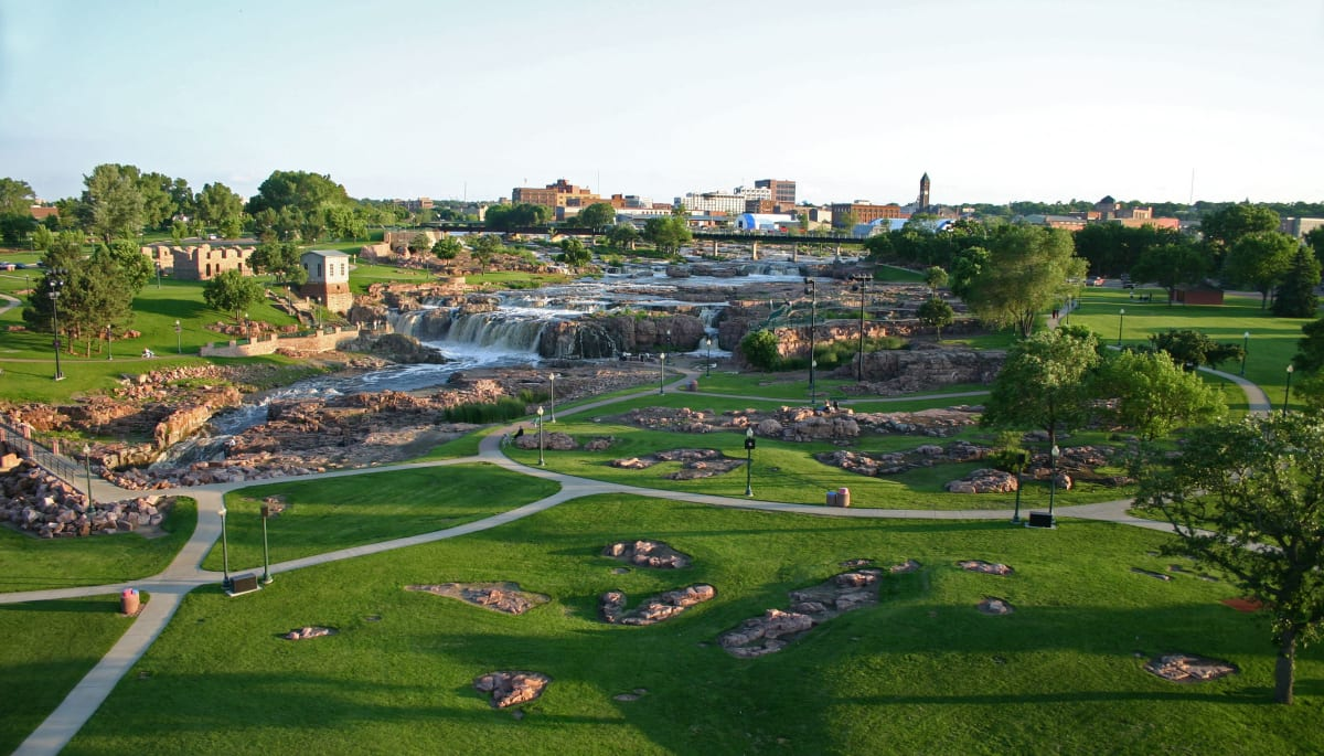 A large park with walkways at Touchmark at All Saints in Sioux Falls, South Dakota