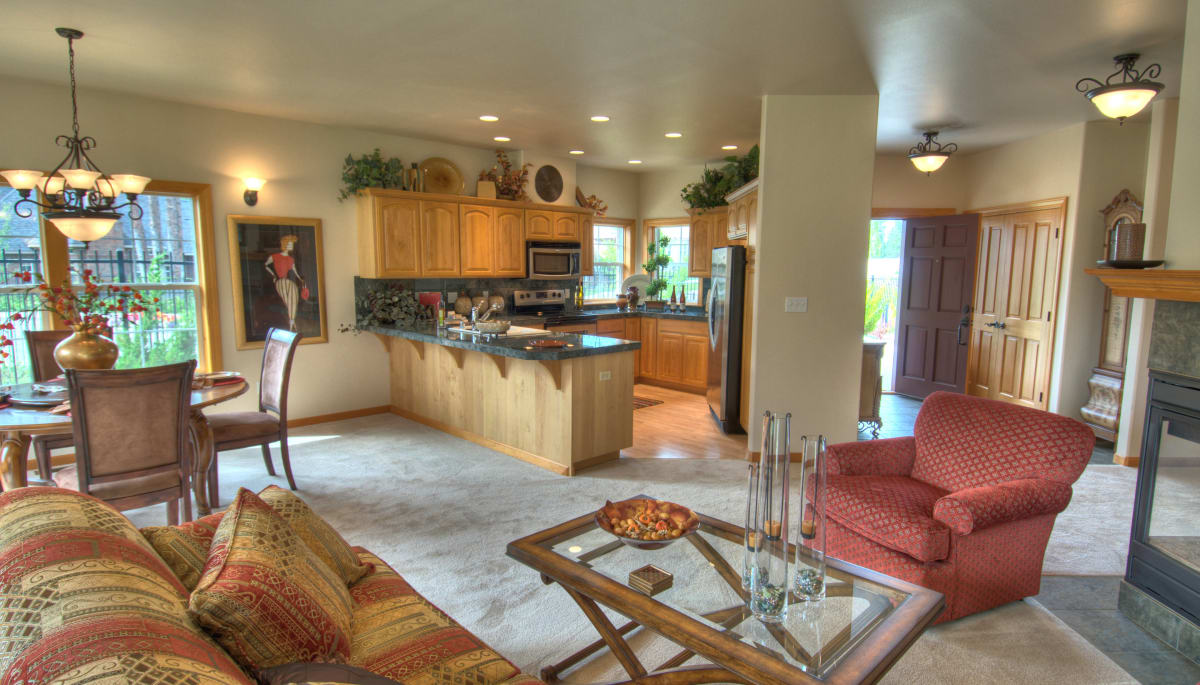 An apartment living room and kitchen at Touchmark on South Hill in Spokane, Washington