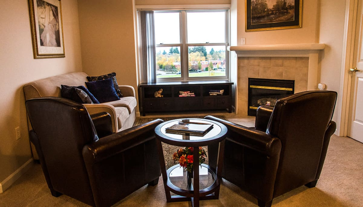 Seating in an apartment living room at Touchmark at Fairway Village in Vancouver, Washington