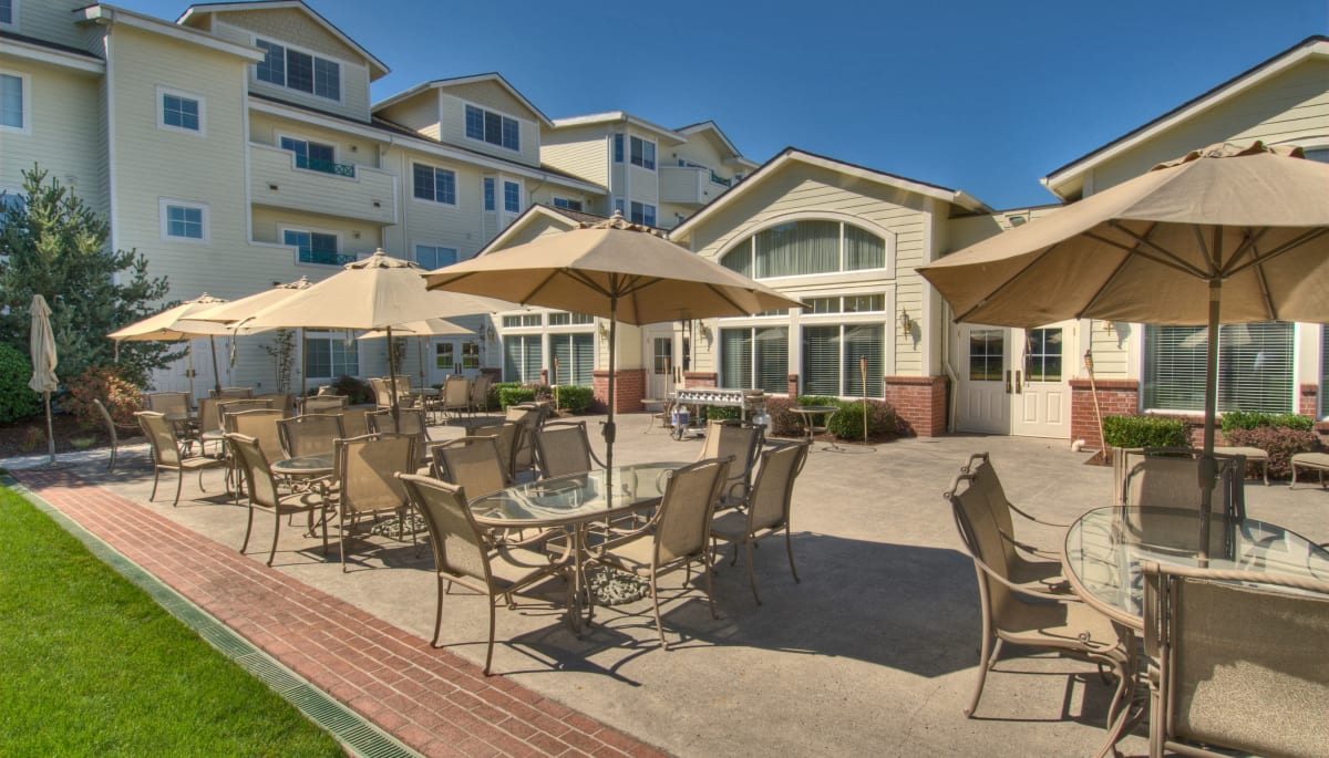 Covered outdoor seating at Touchmark at Fairway Village in Vancouver, Washington