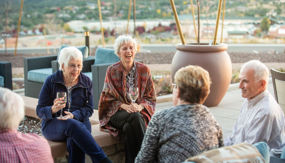 Residents having drinks together outside at Touchmark at The Ranch in Prescott, Arizona