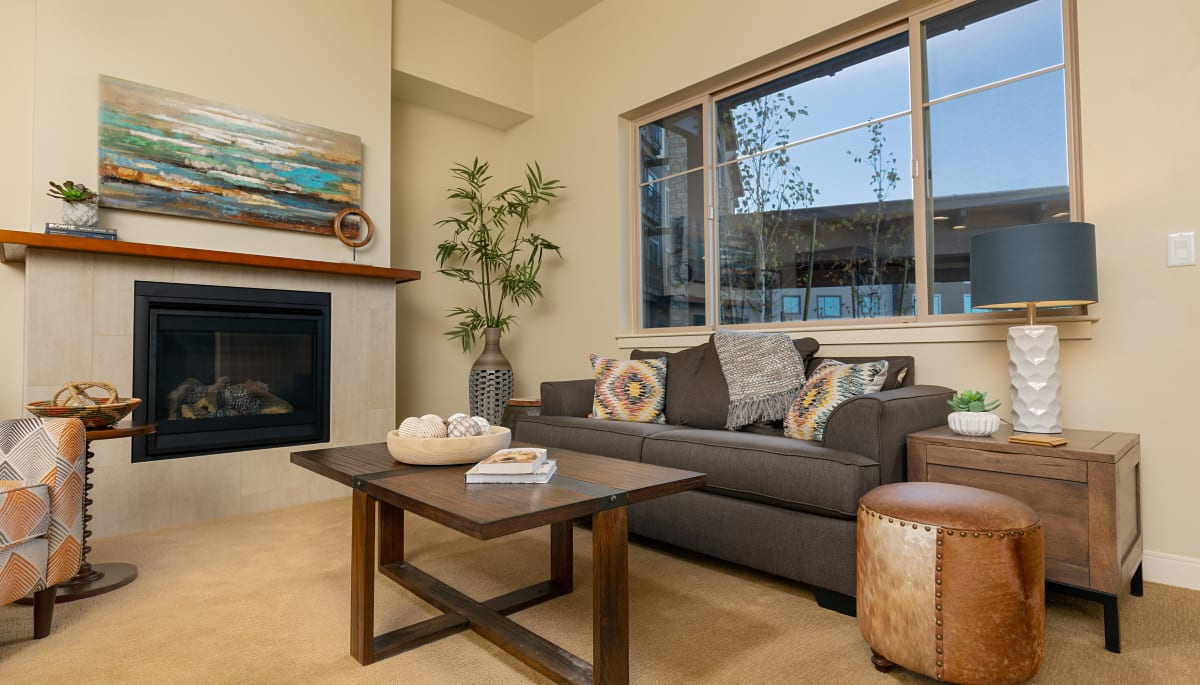 An apartment living room with a fireplace at Touchmark at The Ranch in Prescott, Arizona