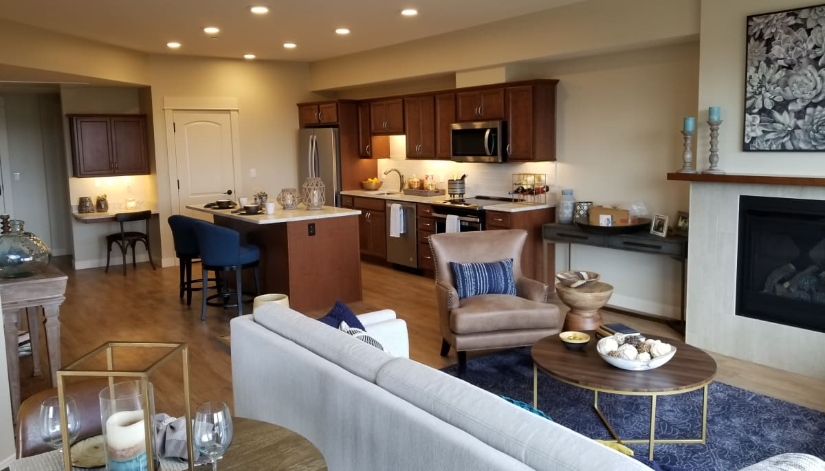 An apartment kitchen with an island at Touchmark at The Ranch in Prescott, Arizona