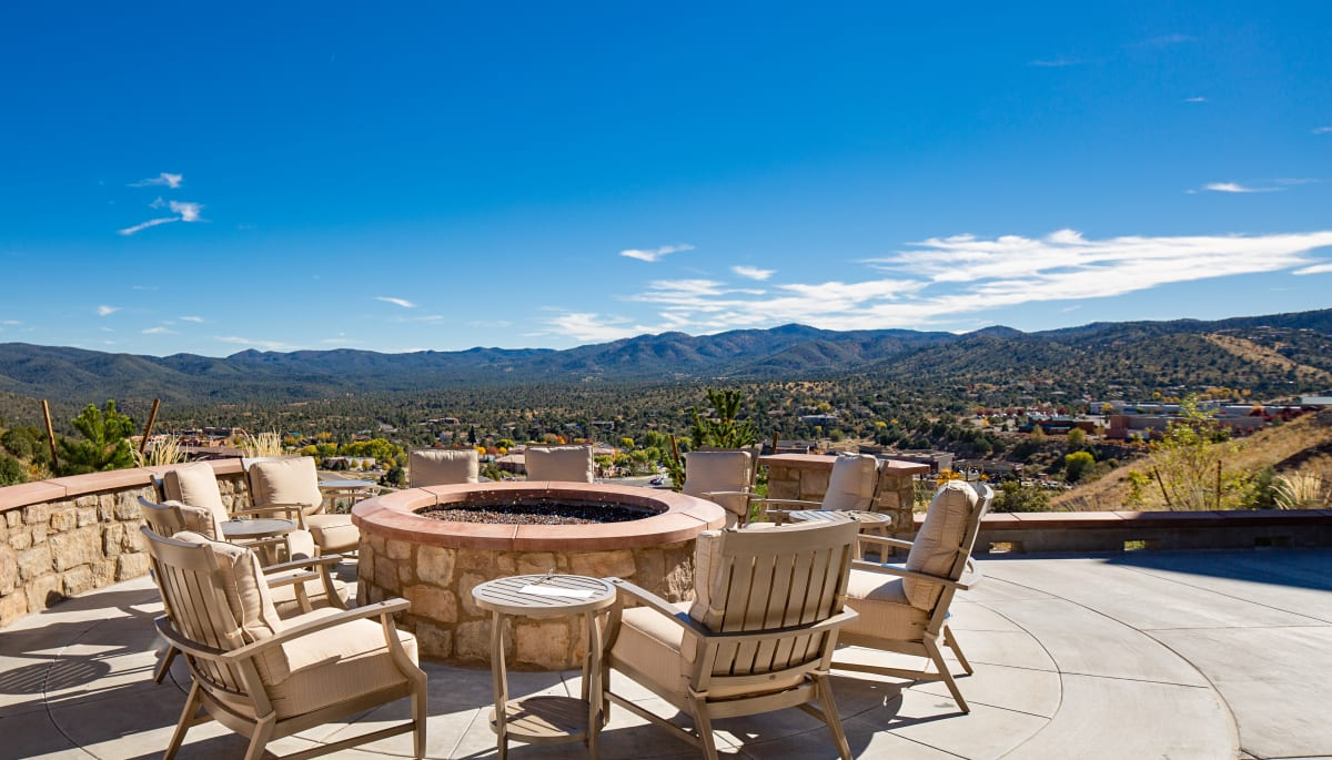 A fire pit with a of the surrounding area of Touchmark at The Ranch in Prescott, Arizona