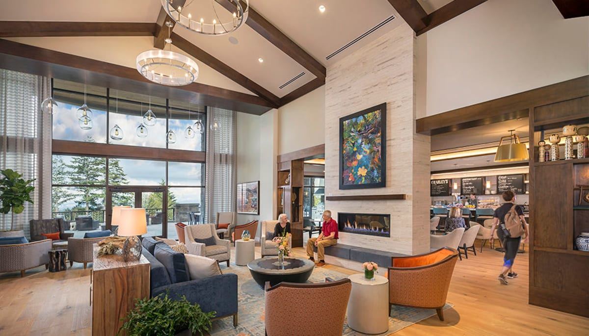 Residents talking in the lobby at Touchmark in the West Hills in Portland, Oregon