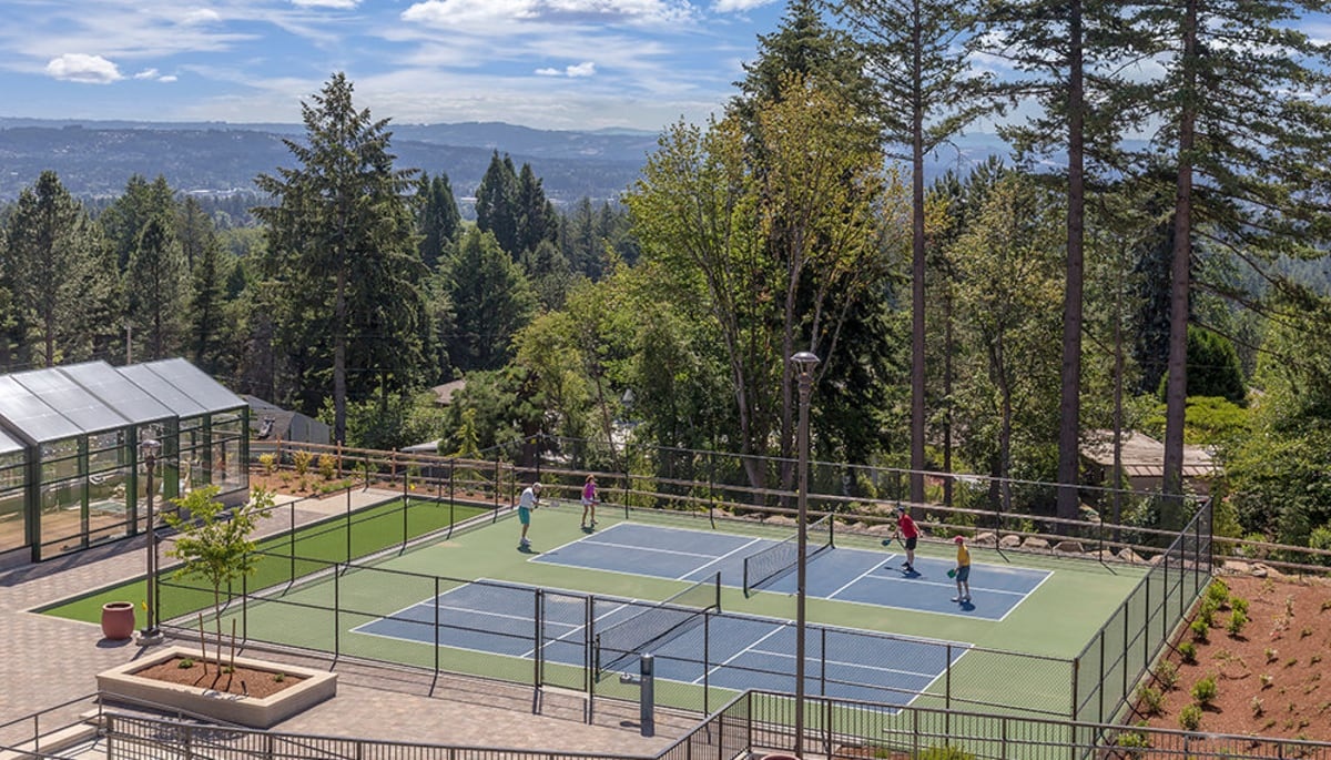 Residents playing a round of tennis at Touchmark in the West Hills in Portland, Oregon